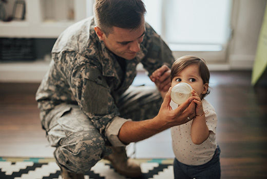Military man and young child